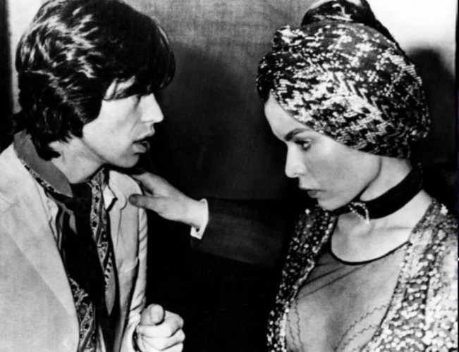 She dazzled her outfits with exotic turbans. None more memorable than the one she wore with Mick Jagger to her wedding party in 1971.